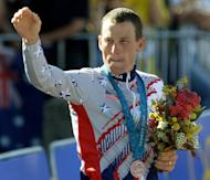 Lance Armstrong celebrates after winning the bronze medal in the men's time trial of the Sydney Olympic Games on September 30, 2000. The International Olympic Committee (IOC) has asked Armstrong to return the Olympic bronze medal he won at the 2000 Games in Sydney