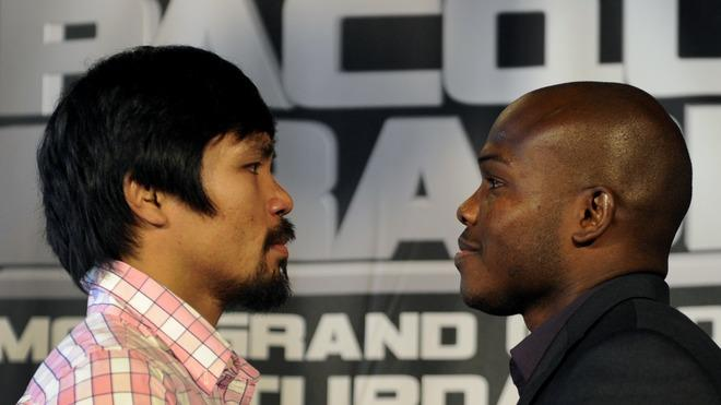 "Undefeated Junior Welterweight Champion Manny ""Pacman""  Pacquiao  Faces Off With Timothy ""Desert Storm""  Bradley AFP/Getty Images"