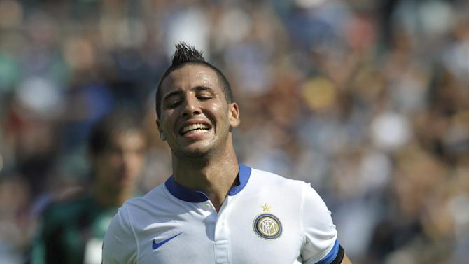 Inter Milan's Saphir Taider, of Algeria, celebrates after scoring during an Italian Serie A soccer match betwees Sassuolo and Inter Milan, at Reggio Emilia's Mapei stadium, Italy, Sunday, Sept. 22, 2013