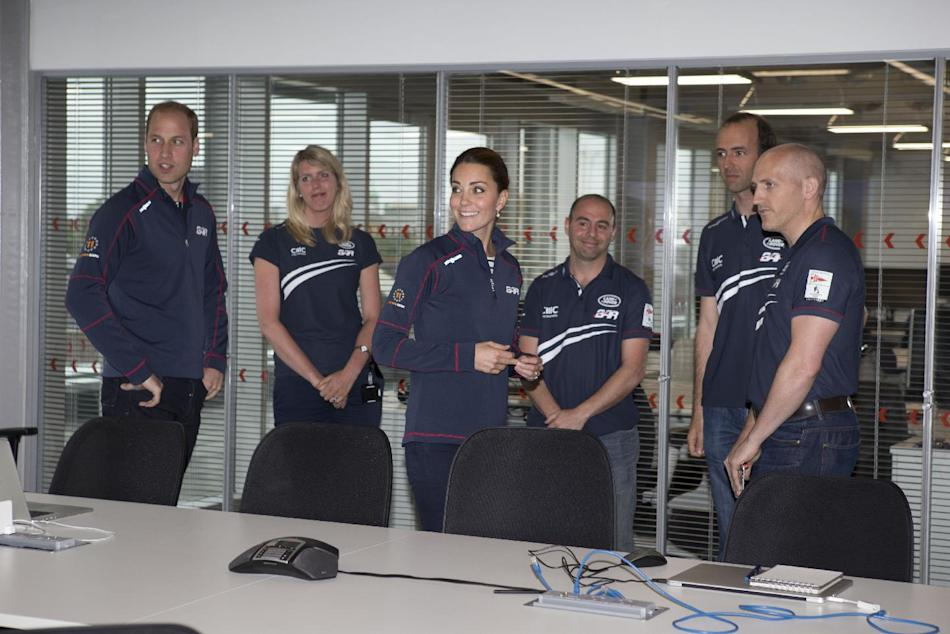Kate, the Duchess of Cambridge, centre accompanied by Britain's  Prince William,  on a visit to the new BAR, Ben Ainslie Racing team base for the America's Cup World Series, in Portsmouth, Eng