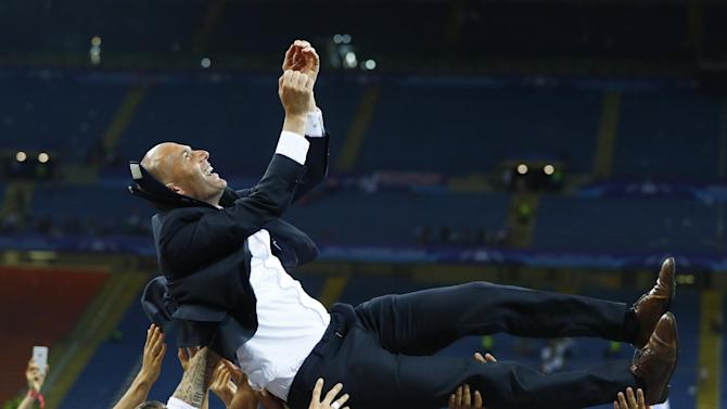 Real Madrid players give coach Zinedine Zidane the bumps as they celebrate winning the UEFA Champions League