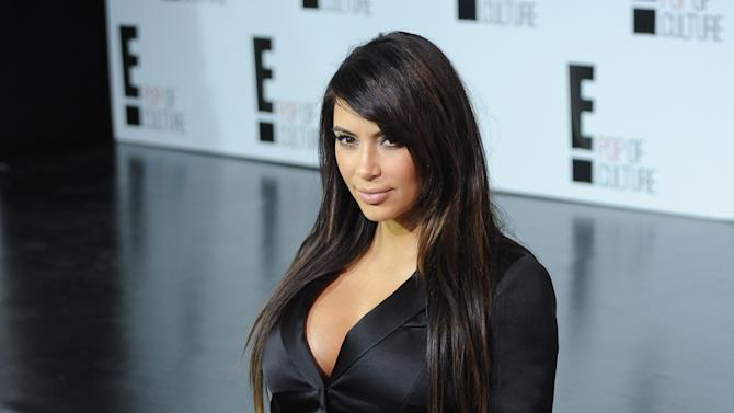 "Kim Kardashian from ""Keeping Up With The Kardashians"" attends the E! Network 2013 Upfront at the Manhattan Center on Monday April 22, 2013 in New York. (Photo by Evan Agostini/Invision/AP)"