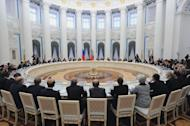 Russian President Vladimir Putin speaks to G20 states finance ministers in the Kremlin in Moscow on February 15, 2013. G20 finance ministers have pledged to crack down on corporate tax avoidance and not to target specific exchange rate values that could spark a currency war, the final communique said