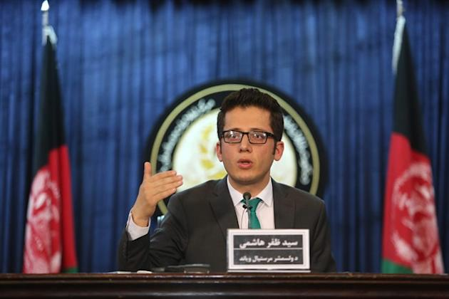 Zafar Hashemi, a deputy spokesman for Afghan President Ashraf Ghani, speaks during a press conference in Kabul, Afghanistan, Wednesday, July 29, 2015. An Afghan official said Wednesday his government