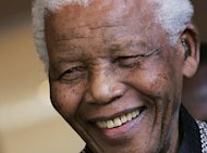 South Africa's anti-apartheid icon Nelson Mandela, pictured here in Johannesburg on March 26, 2008, was convalescing at his Johannesburg home on Thursday, receiving further care after a nearly three-week hospital stay, officials said.