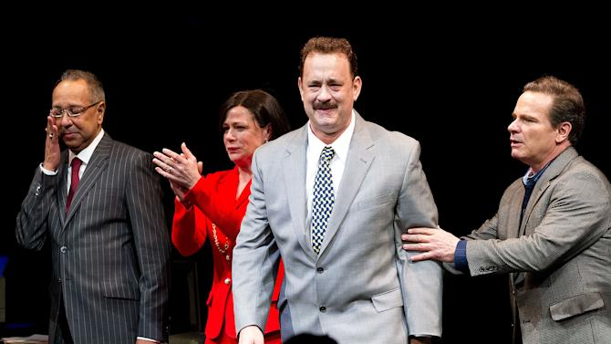 "This April 1, 2013 file photo shows, from left, George C. Wolfe, Maura Tierney, Tom Hanks and Peter Scolari at the Lucky Guy Opening Night, in New York. Hanks received a Tony nomination for best leading actor in a play, Tuesday, April 30, for his role in ""Lucky Guy."" The awards will be broadcast on CBS from Radio City Music Hall on June 9.  (Photo by Dario Cantatore/Invision/AP, file)"