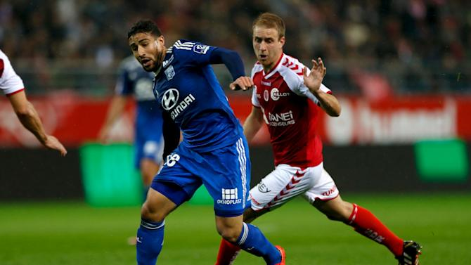 Olympique Lyon's Nabil Fekir challenges Reims' Alexi Peuget during their French Ligue 1 soccer match at Auguste-delaune stadium in Reims