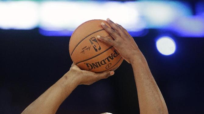 Former NBA player Karl Malone shoots during the skills competition at the NBA All Star basketball game, Saturday, Feb. 15, 2014, in New Orleans