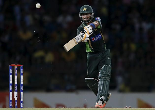 Pakistan's Shehzad hits boundary during their first Twenty 20 cricket match against Sri Lanka in Colombo