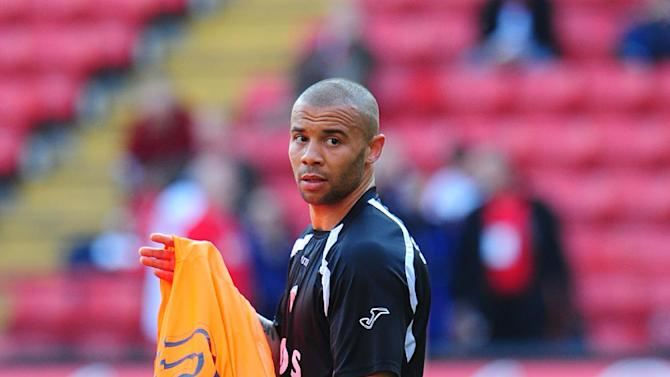 Gillingham have completed the signing of Deon Burton on a one-year deal