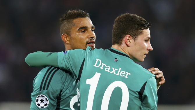 Schalke 04's Draxler reacts with Boateng during Champions League soccer match against Basel in Basel
