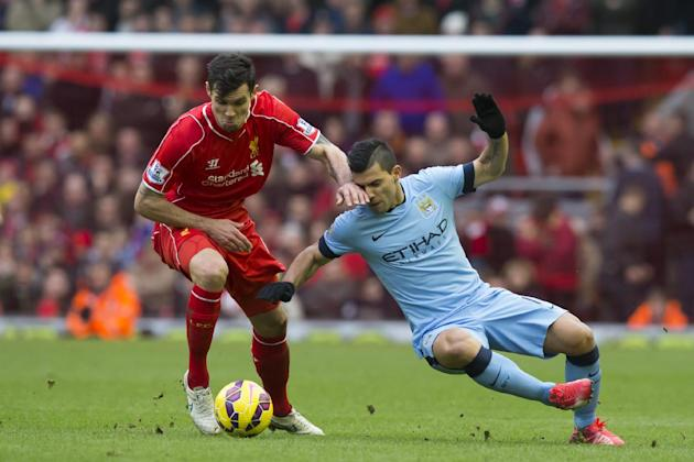 Liverpool's Dejan Lovren, left, fights for the ball against Manchester City's Sergio Aguero during the English Premier League soccer match between Liverpool and Manchester City at Anfield Stad