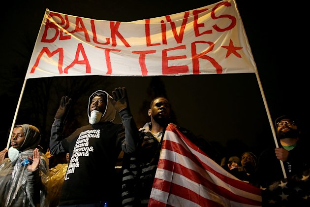 ST. LOUIS, MO - NOVEMBER 23: Demonstrators march through the streets while protesting the shooting death of 18-year-old Michael Brown on November 23, 2014 in St. Louis, Missouri. Tensions in Ferguson remain high as a grand jury is expected to decide this month if Ferguson police officer Darren Wilson should be charged in the shooting death of Michael Brown. (Photo by Justin Sullivan/Getty Images)