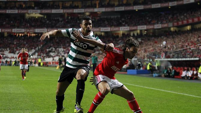Benfica's Lazar Markovic, right, from Serbia vies for the ball with Sporting's Mauricio Nascimento from Brazil during a Portugal Cup soccer match between Benfica and Sporting at Benfica's Luz stadium in Lisbon, Saturday, Nov. 9, 2013