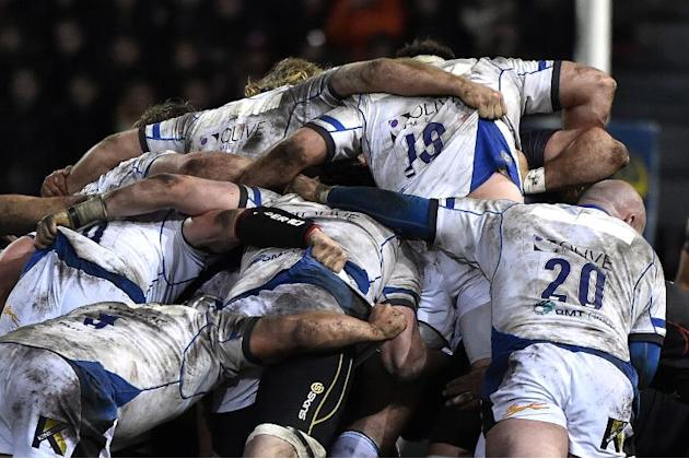 Bath's players take part in a scrum during the European Rugby Union Champions Cup match on January 18, 2015