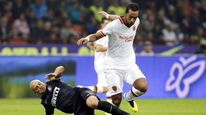 AS Roma's Benatia and Inter Milan's Cambiasso fight for the ball during their Italian Serie A soccer match in Milan