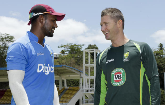 West Indies captain Denesh Ramdin, left, and Australia captain Michael Clarke, rsmile during a photo opportunity for press, in Roseau, Dominica, Tuesday, June 2, 2015. The first cricket Test match bet