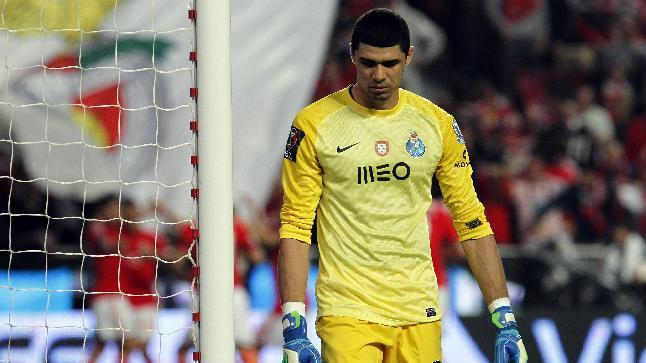 Porto's goalkeeper Fabiano Freitas, from Brazil, looks down after Benfica's Eduardo Salvio, from Argentina, scored the opening goal during a Portugal Cup semifinal second leg soccer match between Benfica and Porto at Benfica's Luz stadium in Lisbon, Wednesday, April 16, 2014.  Benfica won 3-2 on aggregate and will play the final