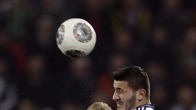 Augsburg's Andre Hahn, foreground, and Schalke's Sead Kolasinac challenge for the ball during the German first division Bundesliga soccer match between FC Augsburg and FC Schalke 04, in Augsburg, southern Germany, Friday, March 14, 2014