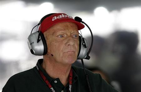Former Formula One champion Lauda of Austria follows the first practice session of the Bahrain F1 Grand Prix at the Sakhir circuit