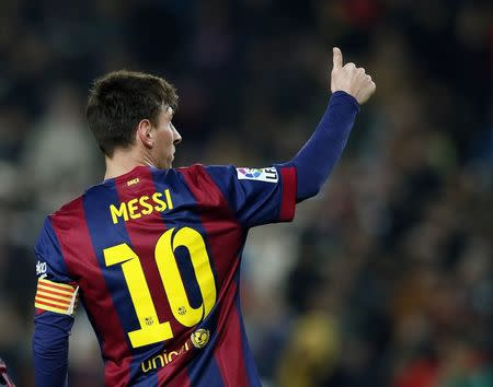 Barcelona's Lionel Messi celebrates a goal against Elche during their Spanish King's Cup trophy match at Camp Nou stadium in Barcelona