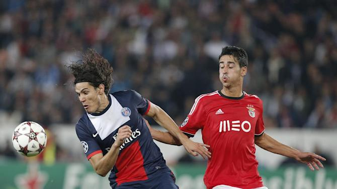 PSG's Edinson Cavani, left, challenges for the ball with Benfica's Andre Almeida during the Champions League group C soccer match between Paris Saint Germain and Benfica, at the Parc des Princes stadium, in Paris, Wednesday, Oct. 2, 2013