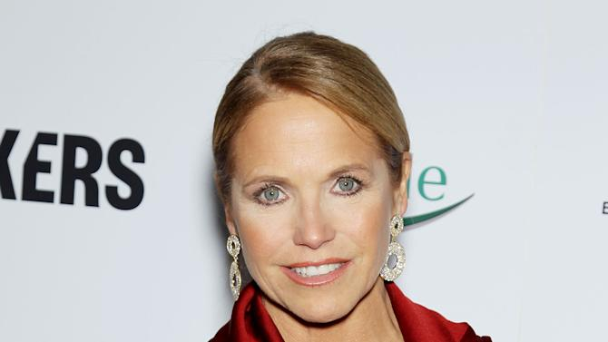 """FILE - This Feb. 6, 2013 file photo released by Starpix shows TV personality Katie Couric at the premiere of """"Makers: Women Who Make America"""" at Alice Tully Hall at Licoln Center in New York. New York City police said Thursday, Feb. 14, 2013, they had been called to Couric's Manhattan home several times recently because of 911 calls traced to a phone listed there. The 911 operator hears only static, but police are compelled to answer each call. The calls come on Tuesdays at 2 a.m., as Couric told an audience at her talk show's taping this week. Police say they are investigating whether something's wrong with her phone or if Couric is the victim of a high-tech prankster.  (AP Photo/Starpix, Marion Curtis)"""