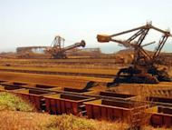 File photo taken in 2010 shows iron ore carriers at Rio Tinto's Dampier port in Western Australia. Australian PM Julia Gillard Tuesday denied claims that the mining boom was over, saying its benefits would last decades even as a key forecaster warned more projects may be shelved