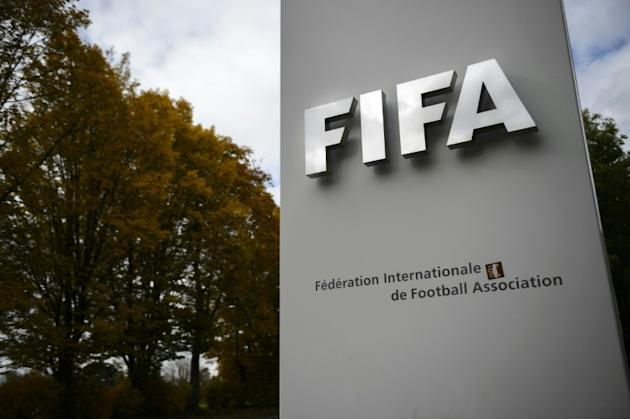 The English and German football associations demand an emergency FIFA executive meeting following the suspension of the world body's president Sepp Blatter and UEFA boss Michel Platini