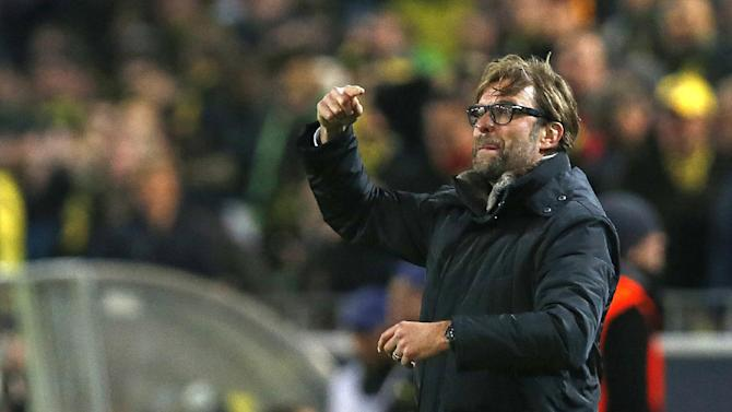 Dortmund head coach Juergen Klopp gestures during the Champions League group F soccer match between Borussia Dortmund and Arsenal FC in Dortmund, Germany, Wednesday,Nov.6,2013