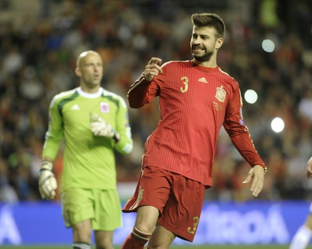 Spain's defender Gerard Pique (R) grimaces during the Euro 2016 qualifying football match Spain vs Luxembourg at Las Gaunas stadium in Logrono on October 9, 2015
