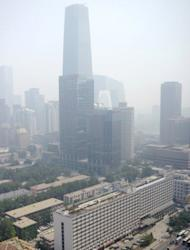 """This general view shows a central business district in Beijing on June 3. In a policy document the State Council, or cabinet, said """"concentrations of fine particles"""" in the capital's air will fall by """"approximately 25 percent"""" from 2012 levels by 2017"""