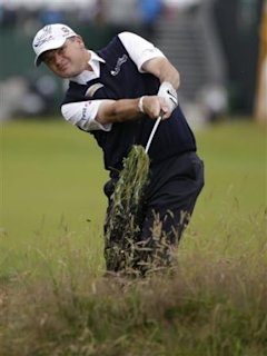 Paul Lawrie of Scotland plays out of rough on 7th fairway at Royal Lytham & St Annes golf club during the first round of the British Open Golf Champio