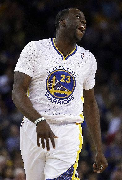 Golden State Warriors' Draymond Green smiles after scoring against the Sacramento Kings during the first half of an NBA basketball game on Saturday, Nov. 2, 2013, in Oakland, Calif