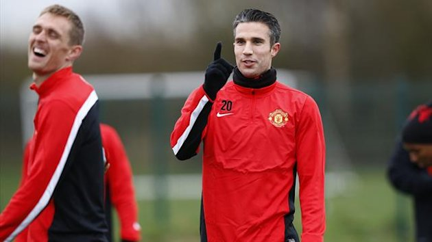 Manchester United's Robin van Persie during a training session at Carrington before the Olympiacos match (Reuters)