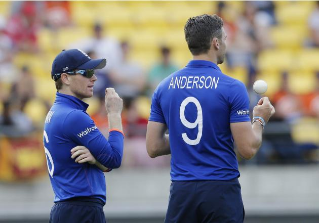 England's Morgan talks to bowler Anderson during their Cricket World Cup match against Sri Lanka in Wellington