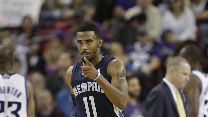 Memphis Grizzlies guard Mike Conley gestures to a teammate in the closing moments of the Grizzlies 97-86 win over the Sacramento Kings in an NBA basketball game in Sacramento, Calif., Sunday, Nov. 17, 2013
