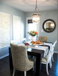 Wallpaper panels make a beautiful addition to this dining room.