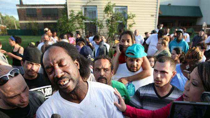 FILE - This May 6, 2013 file photo shows neighbor Charles Ramsey speaking to media near the home where missing women Amanda Berry, Gina DeJesus and Michele Knight were rescued in Cleveland. Ramsey lived next door to where Ariel Castro is alleged to have kept the women in his makeshift prison until Monday afternoon, when Ramsey happened to be home and heard Amanda Berry's scream. (AP Photo/The Plain Dealer, Scott Shaw) MANDATORY CREDIT CLEVELAND PLAIN DEALER