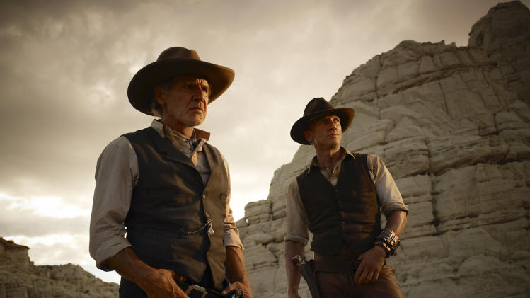 "In this publicity image released by Universal Pictures, Harrison Ford, left, and Daniel Craig are shown in a scene from ""Cowboys & Aliens."" (AP Photo/Universal Pictures, Timothy White)"