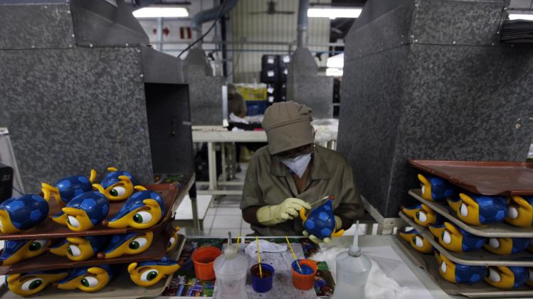 Employee makes stuffed toys of Fuleco the Armadillo, the official mascot of the FIFA 2014 World Cup, at a factory in Sao Bernardo do Campo