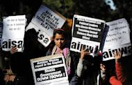 Indian activists protest in New Delhi on December 19, 2012. Riot police have fired water cannon at a protest in New Delhi over the gang-rape of a 23-year-old student who was left fighting for her life as anger against the brutal attack grew across India