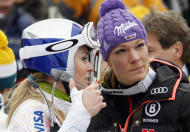 Lindsey Vonn, left, talks to Maria Hoefl-Riesch in the finish area of an alpine ski, women's World Cup slalom, in Lienz, Austria, Thursday, Dec. 29, 2011. (AP Photo/Armando Trovati)