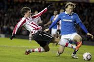 Rangers' Bosnian defender, Sasa Papac (right) vies with PSV Eindhoven's Swedish striker Marcus Berg during their UEFA Europa League match in Glasgow, 2011. Papac believes players at the cash-strapped Glasgow giants could be sacked as administrators look to reduce the Scottish champions' massive debts