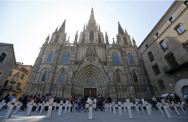 Crosses, placed by Igualdad Animal activists, depict a cemetery as a protest against the use of animals in experiments, in front of Barcelona's cathedral