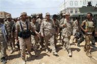 Yemen's Defence Minister Major General Muhammad Nasir Ahmad (3rd R) walks with soldiers as he visits Mayfaa, in the southeastern province of Shabwa May 4, 2014 in this handout photo. REUTERS/Yemen's Defence Ministry/Handout via Reuters