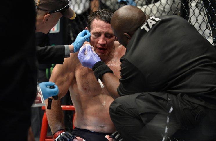 Tim Kennedy, being tended to at UFC 206 after being stopped by Kelvin Gastelum, announced his retirement on Tuesday. (Brandon Magnus/Getty Images)