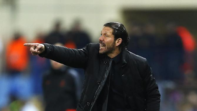 Atletico's coach Diego Simeone gestures during a Champions League Group G soccer match between Atletico Madrid and FC Porto, at the Vicente Calderon stadium in Madrid, Wednesday, Dec. 11, 2013