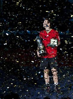 Andy Murray of Britain holds his winning trophy while being showered by confetti after he won the singles final against David Ferrer of Spain in the S