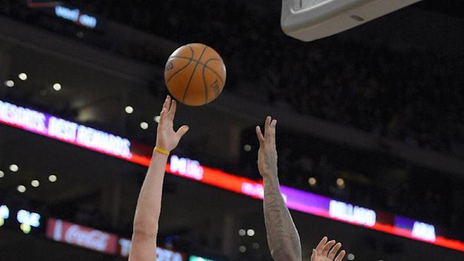 Cleveland Cavaliers center Anderson Varejao, left, of Brazil, puts up a shot as Los Angeles Lakers center Jordan Hill defends during the second half of an NBA basketball game, Tuesday, Jan. 14, 2014, in Los Angeles